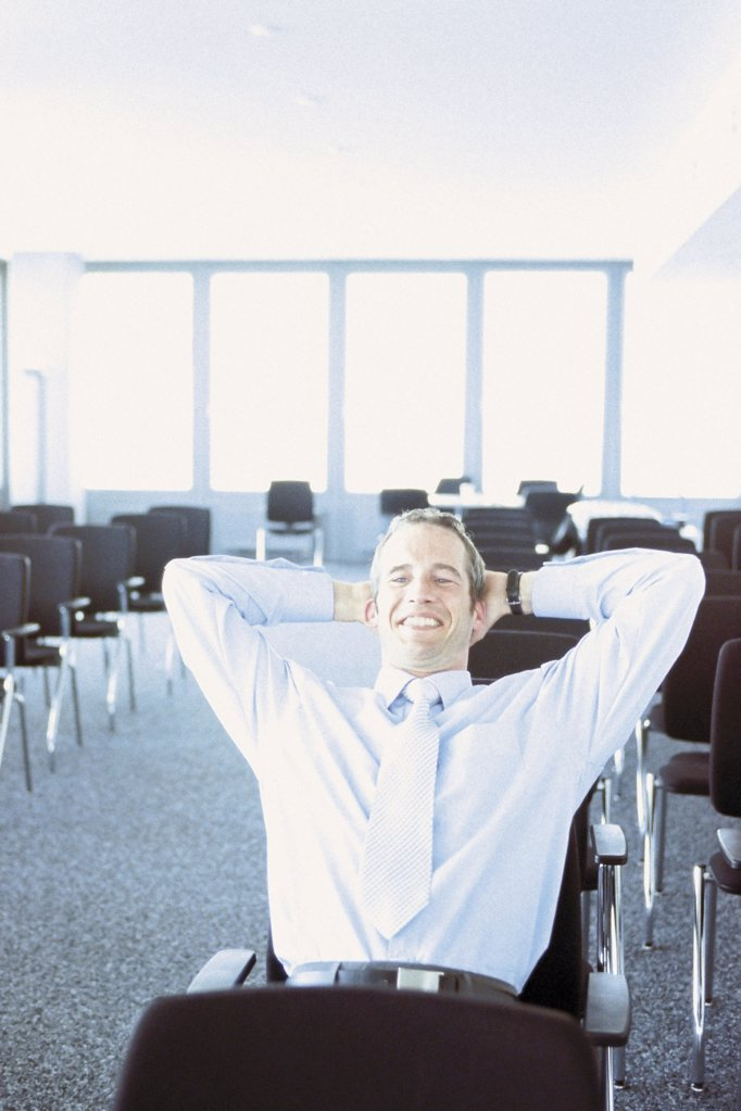 Businessman in conference hall : Stock Photo