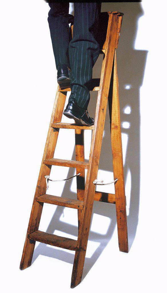 Climbing the ladder : Stock Photo