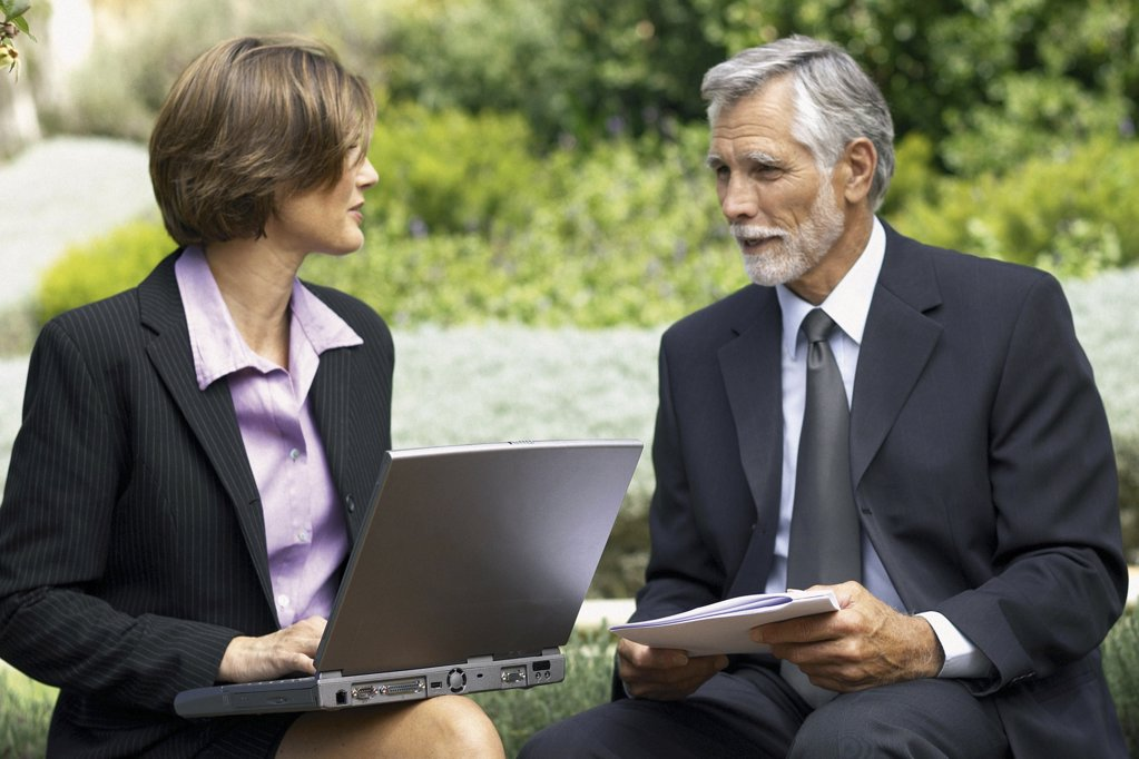 Stock Photo: 1439R-121033 Businessman and businesswoman in a meeting outside