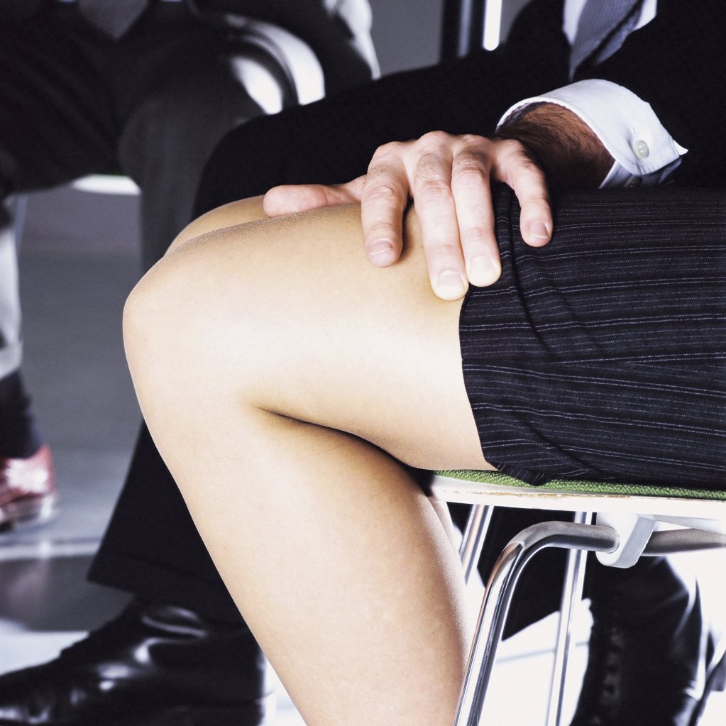 Stock Photo: 1439R-122021 Man touching the legs of a woman.