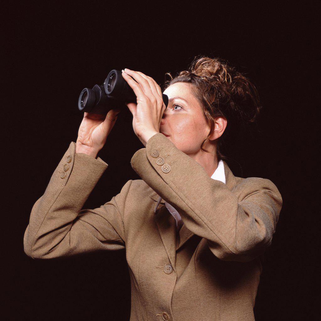 Businesswoman with binoculars : Stock Photo