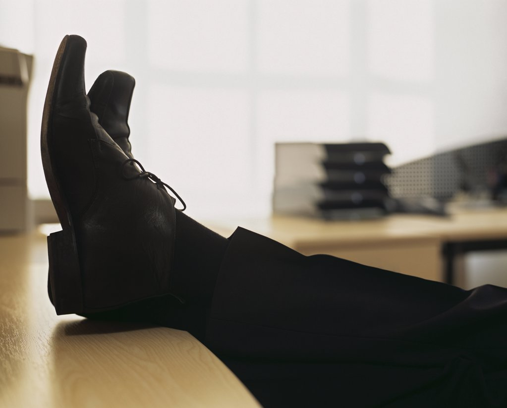 Businessman with feet on desk : Stock Photo