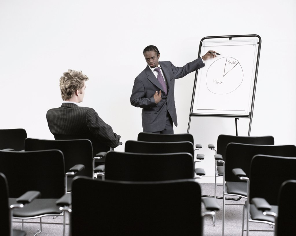 Stock Photo: 1439R-152053 Two businessmen in conference room