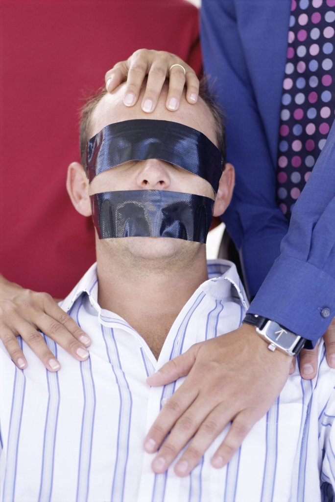 Stock Photo: 1439R-161081 Office worker taken hostage