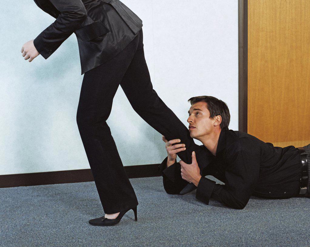 Stock Photo: 1439R-167013 Man grabbing woman's leg