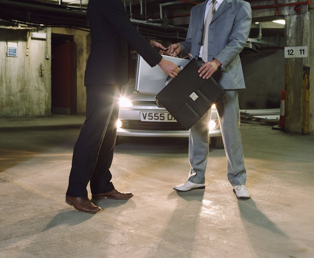 Gangsters swapping briefcases : Stock Photo