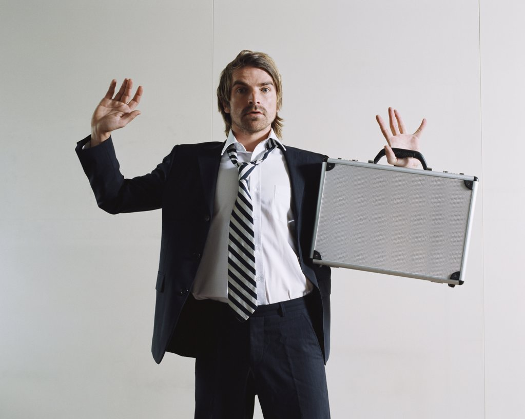 Businessman surrendering : Stock Photo