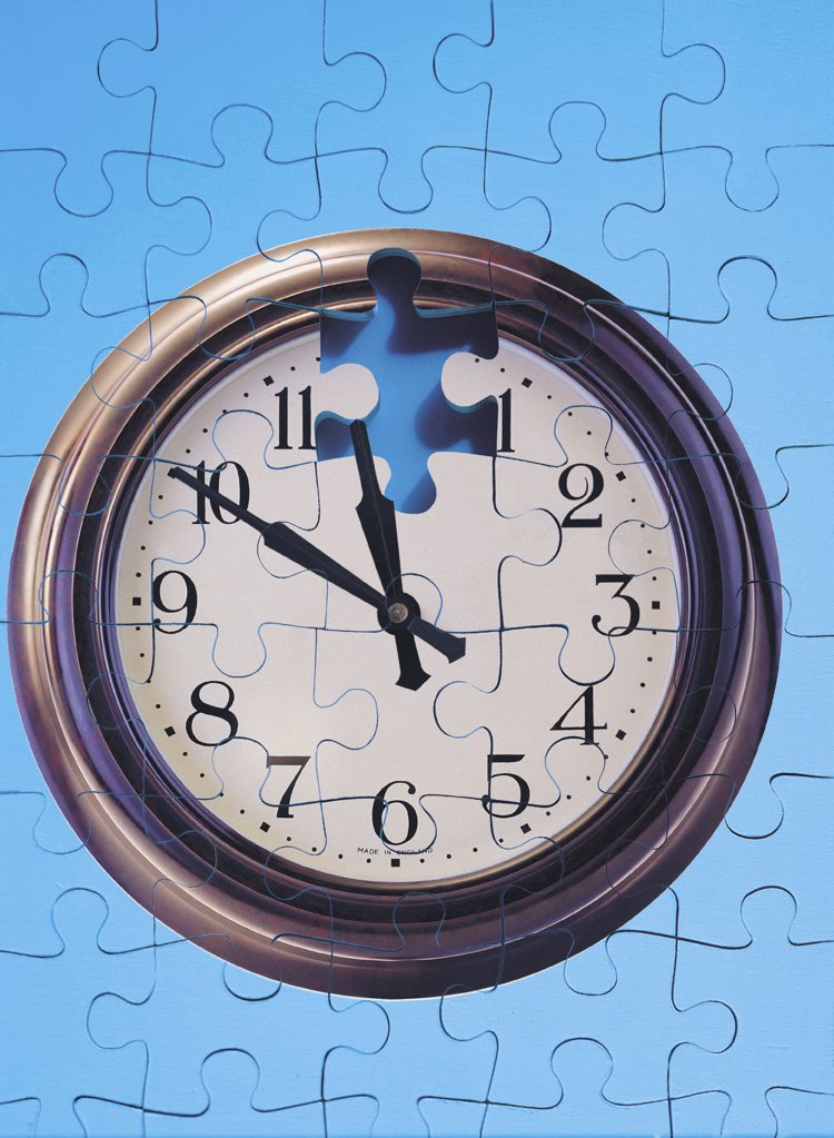 Stock Photo: 1439R-20005 Clock and jigsaw