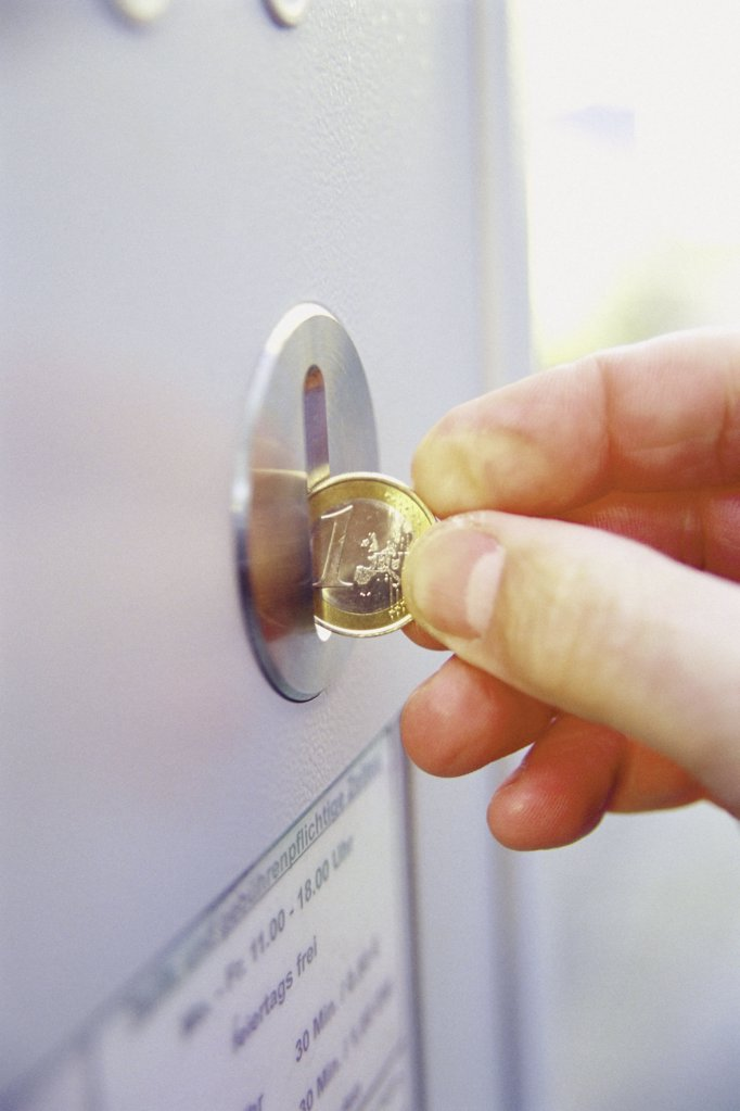 Machine accepting euro coins : Stock Photo