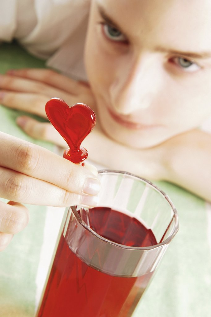 Girl with heart shaped straw : Stock Photo
