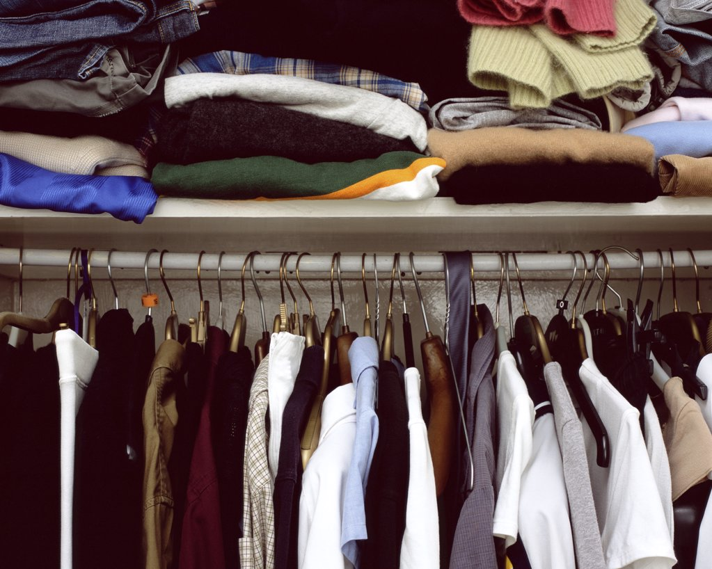 Stock Photo: 1439R-249007 Clothes in cupboard