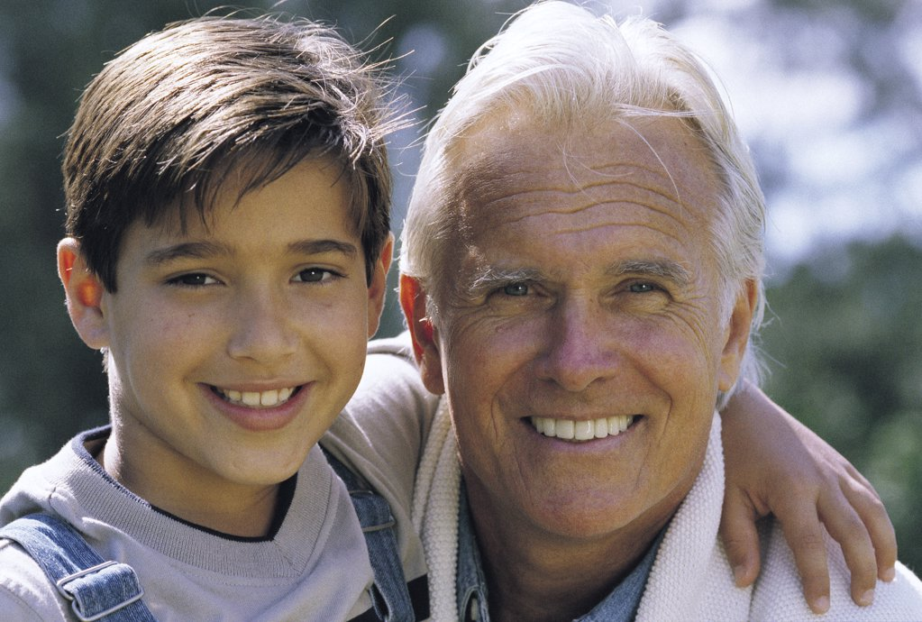 Mature man and boy : Stock Photo