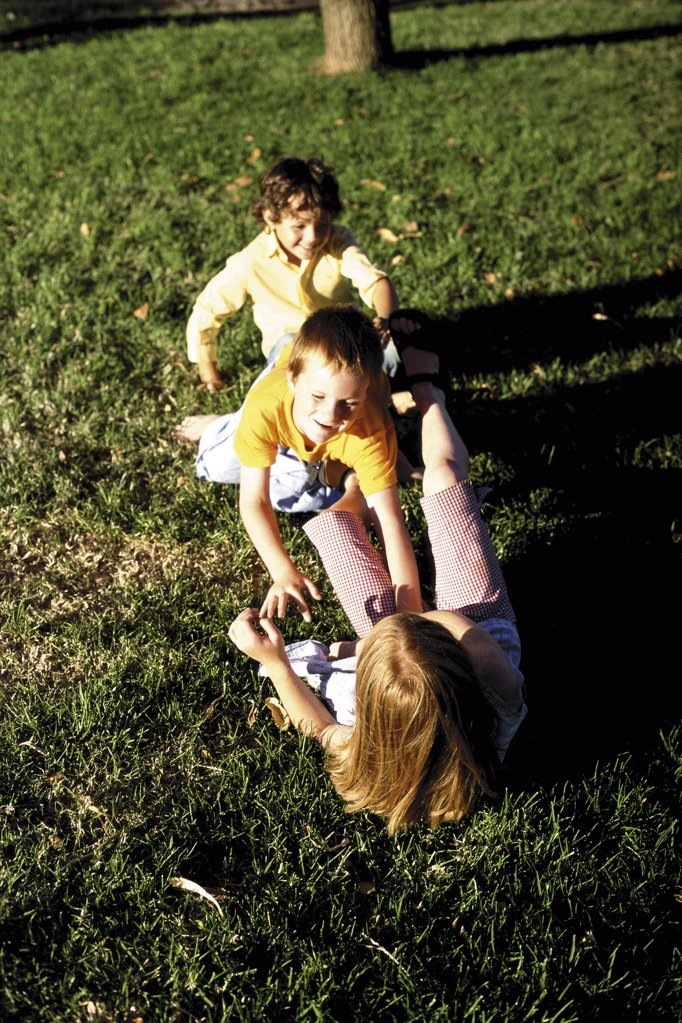Stock Photo: 1439R-47039 Kid playing on the grass