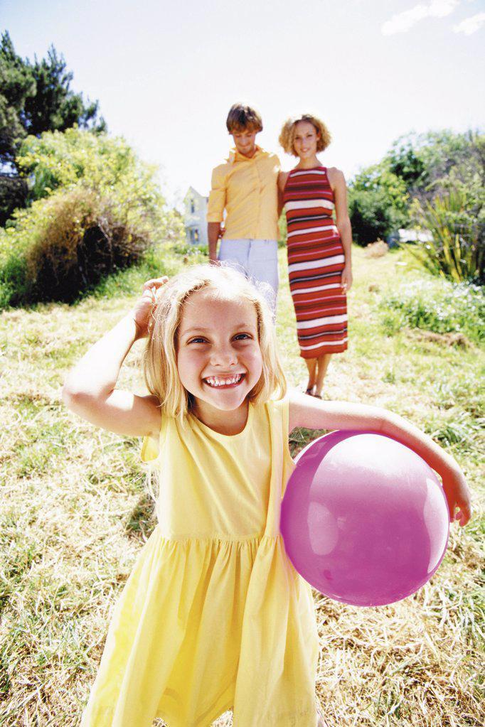 Girl holding ball : Stock Photo