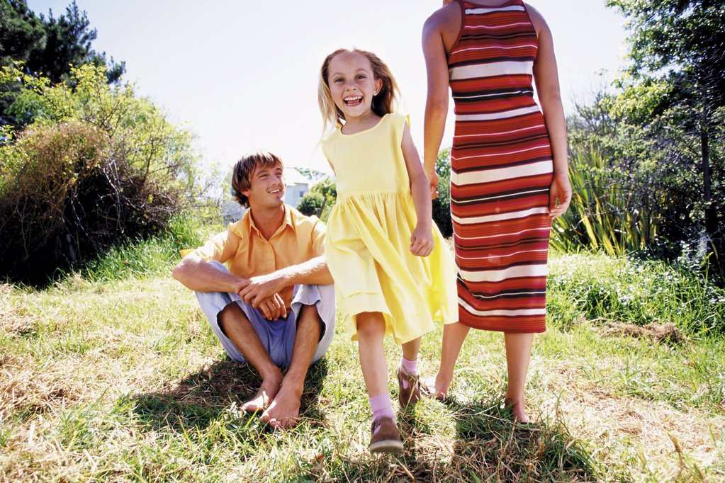 Stock Photo: 1439R-50068 Happy girl with parents