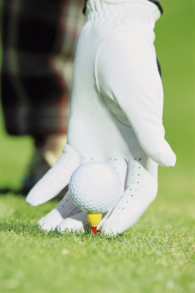 Stock Photo: 1439R-501034 Gloved hand with golf ball