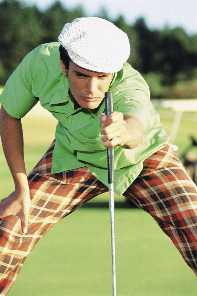 Man playing golf : Stock Photo
