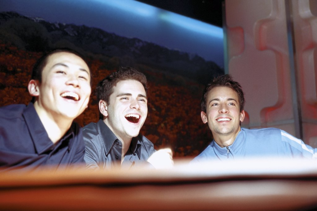 Stock Photo: 1439R-505051 Men laughing in nightclub