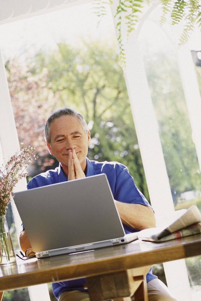 Man using laptop computer : Stock Photo
