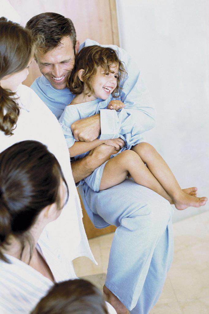 Stock Photo: 1439R-51089 Family having fun at home