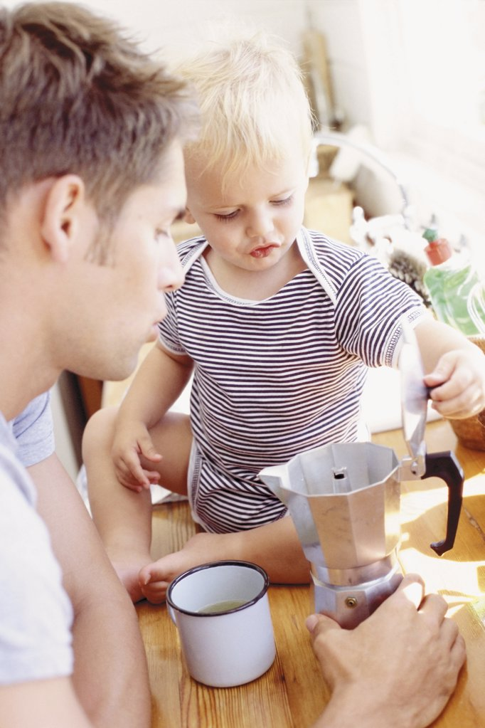 Father and child having breakfast  : Stock Photo