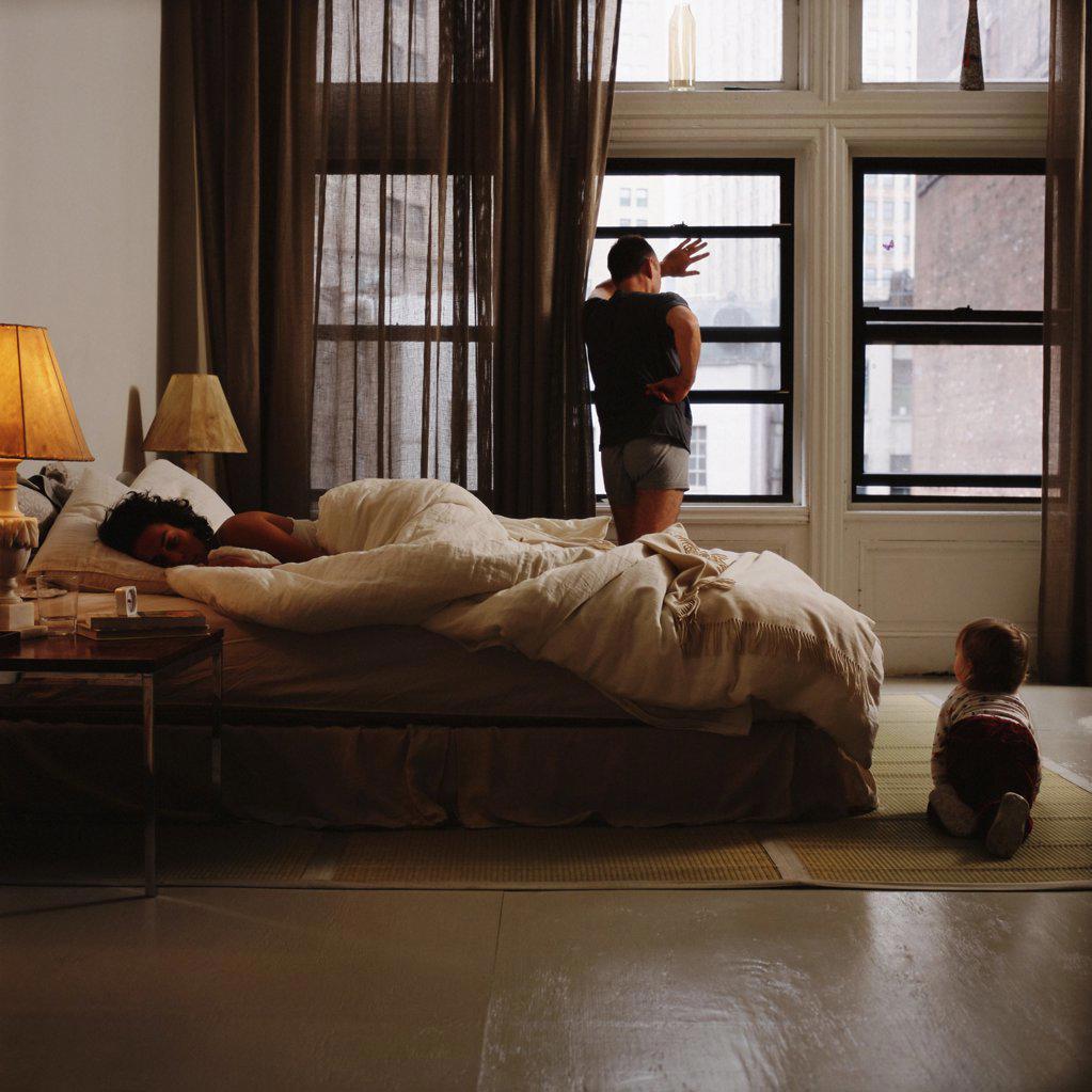 Family in bedroom : Stock Photo
