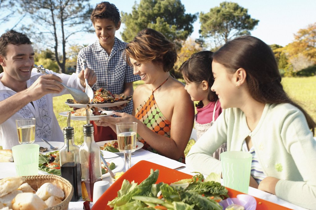 Stock Photo: 1439R-539031 Family eating in garden