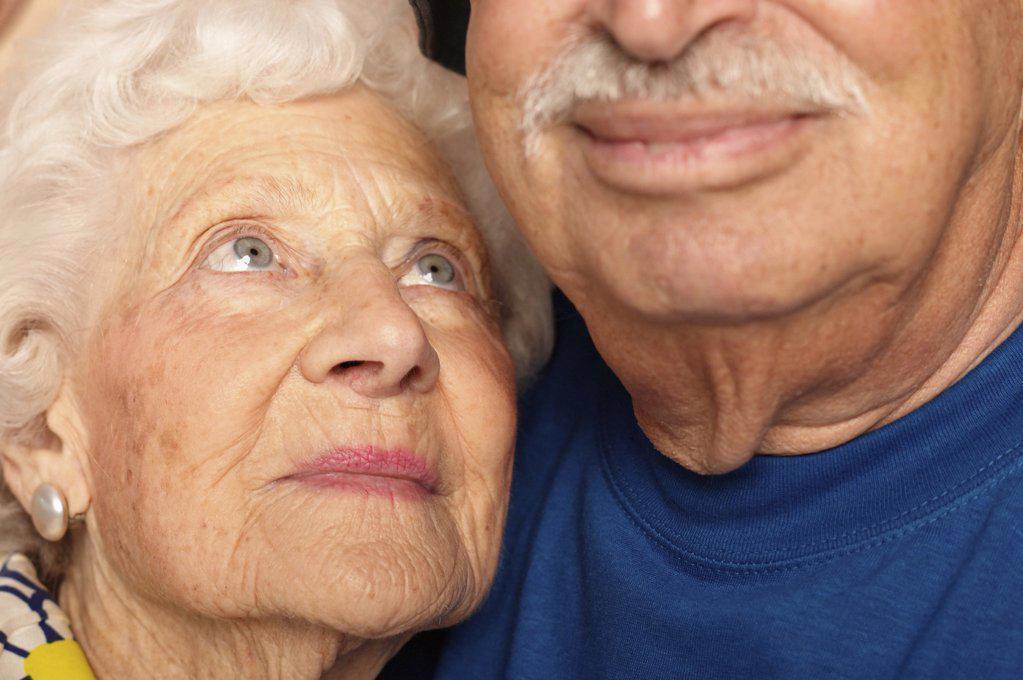 Stock Photo: 1439R-541059 Elderly couple cheek by jowl