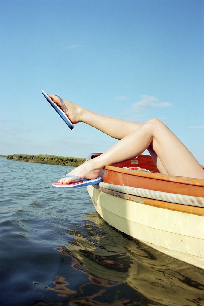 Sunbathing on a boat : Stock Photo