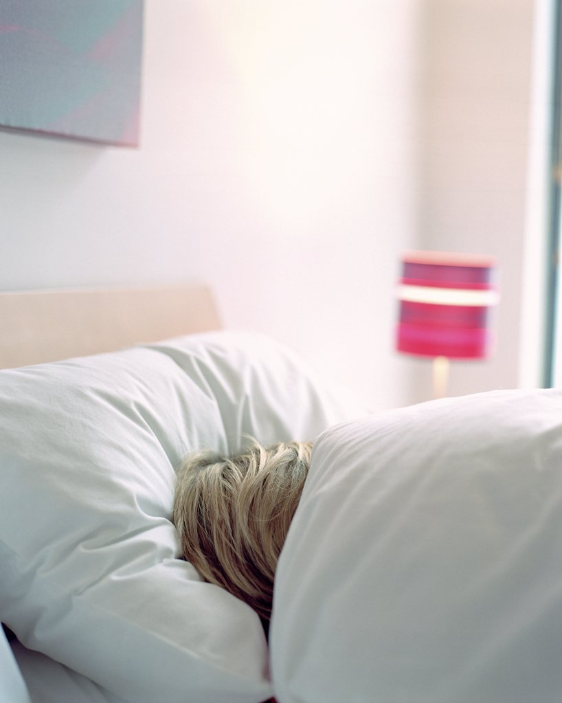 Stock Photo: 1439R-567001 Woman sleeping in bed