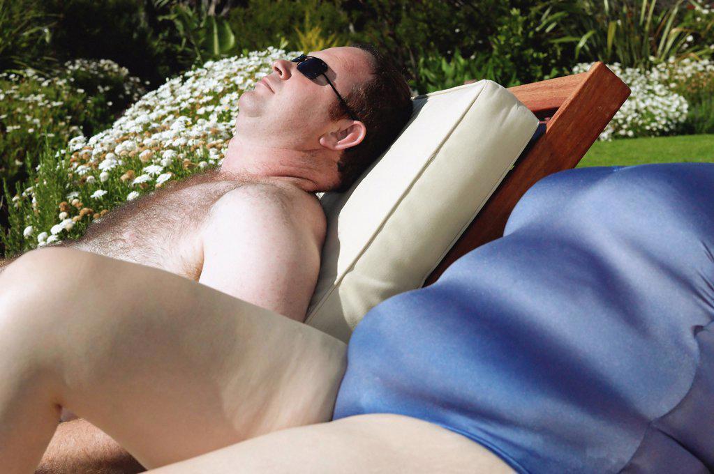 Overweight couple sunbathing : Stock Photo