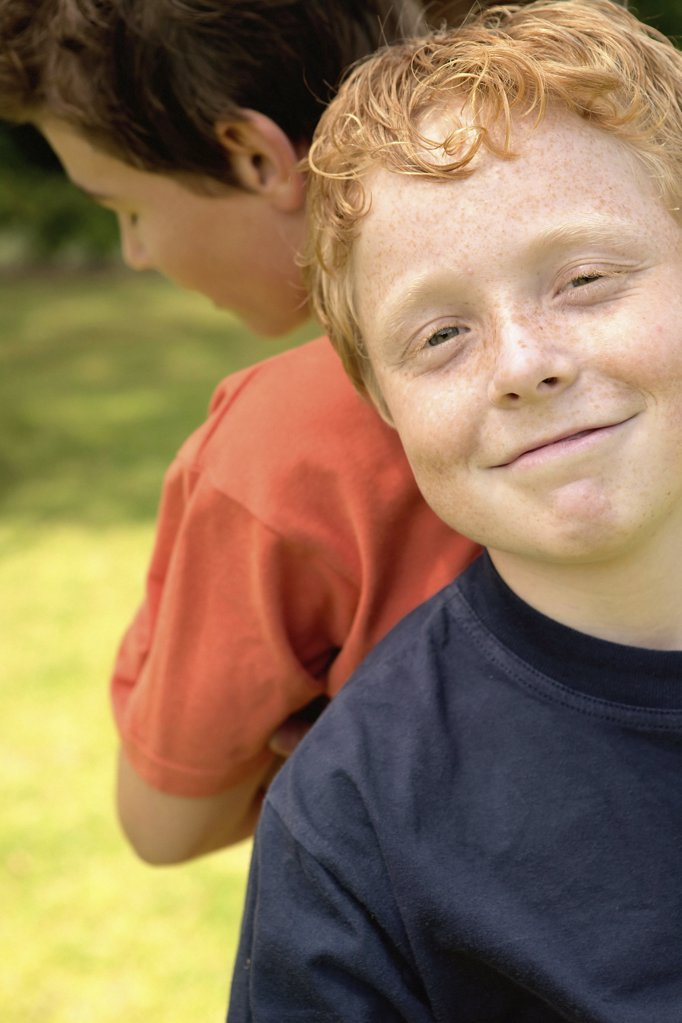 Smiling boy with friend  : Stock Photo