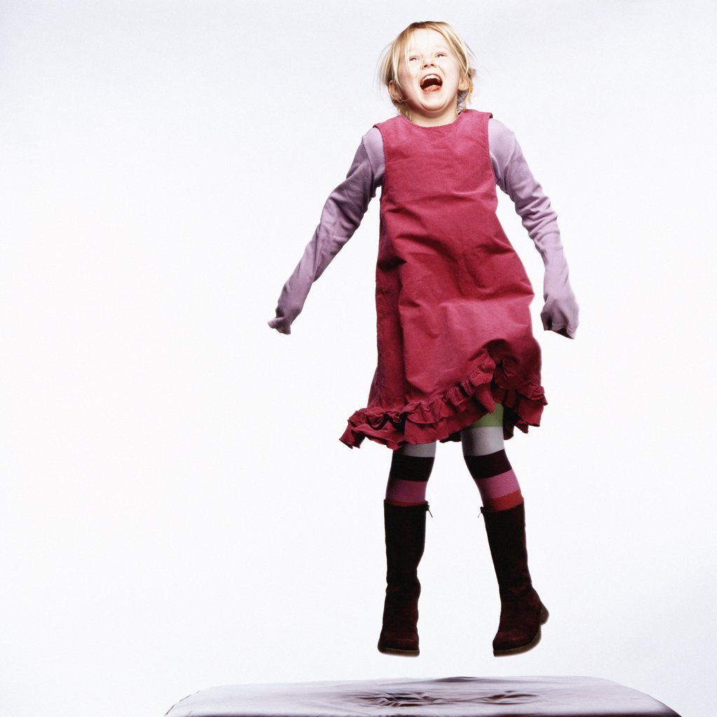 Stock Photo: 1439R-588011 Young girl jumping