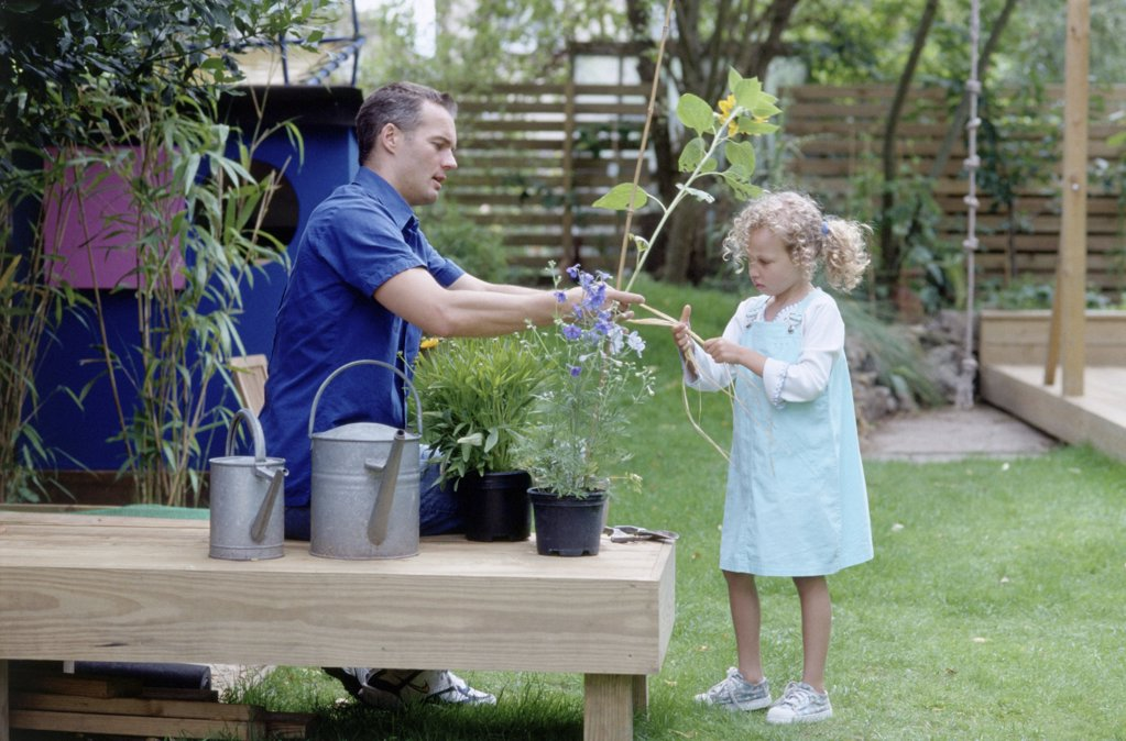 Father and daughter in garden : Stock Photo