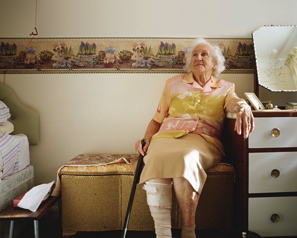 Elderly woman in her room  : Stock Photo