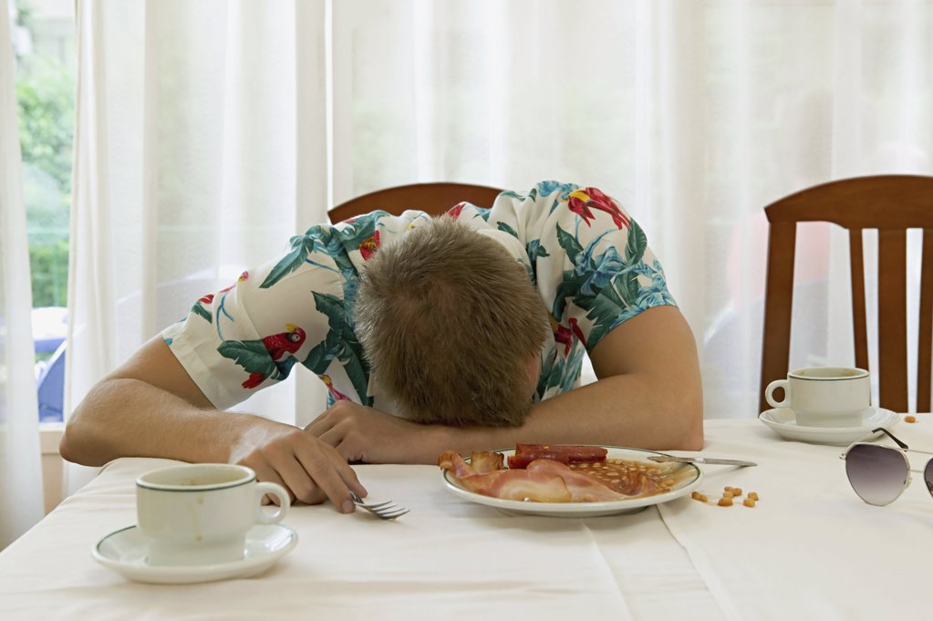 Stock Photo: 1439R-638072 Man asleep at breakfast table