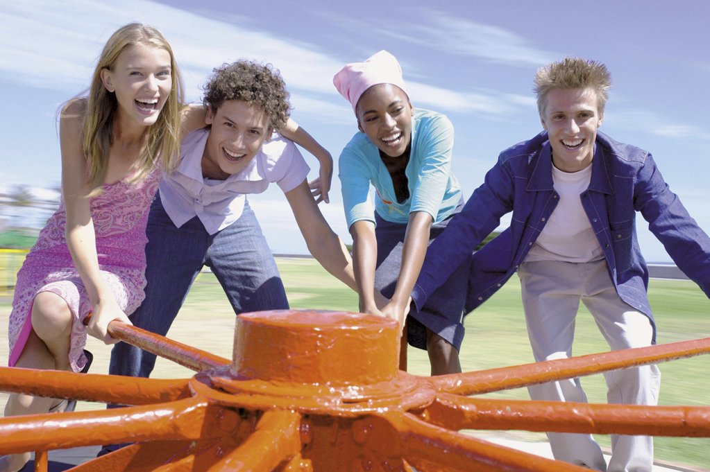 Group spinning roundabout : Stock Photo