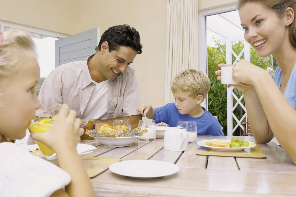 Family at breakfast : Stock Photo