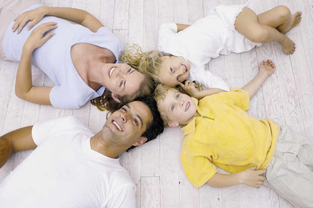Stock Photo: 1439R-65036 Family lying on the floor