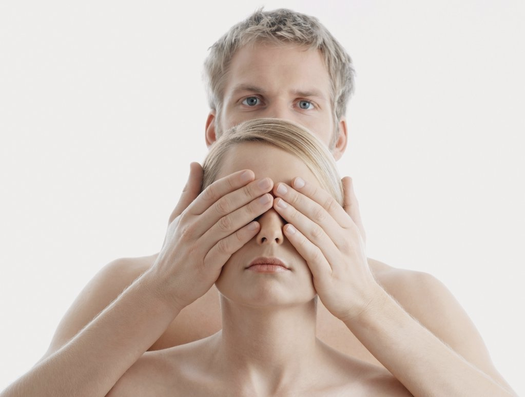 Man covering woman's eyes : Stock Photo