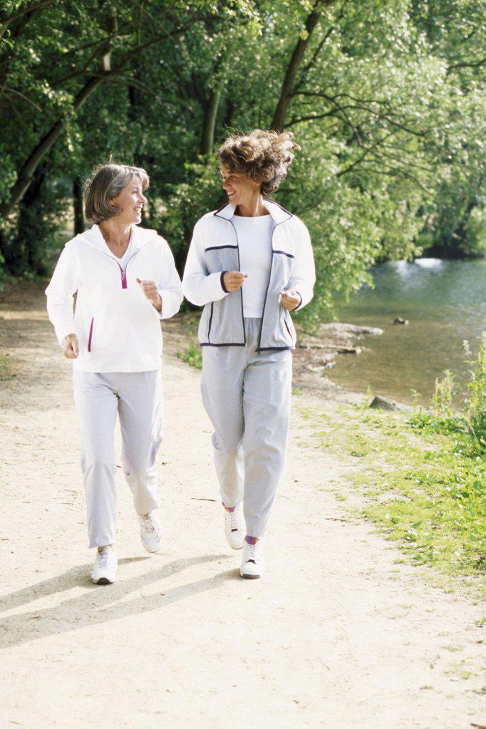 Stock Photo: 1439R-79034 Women walking