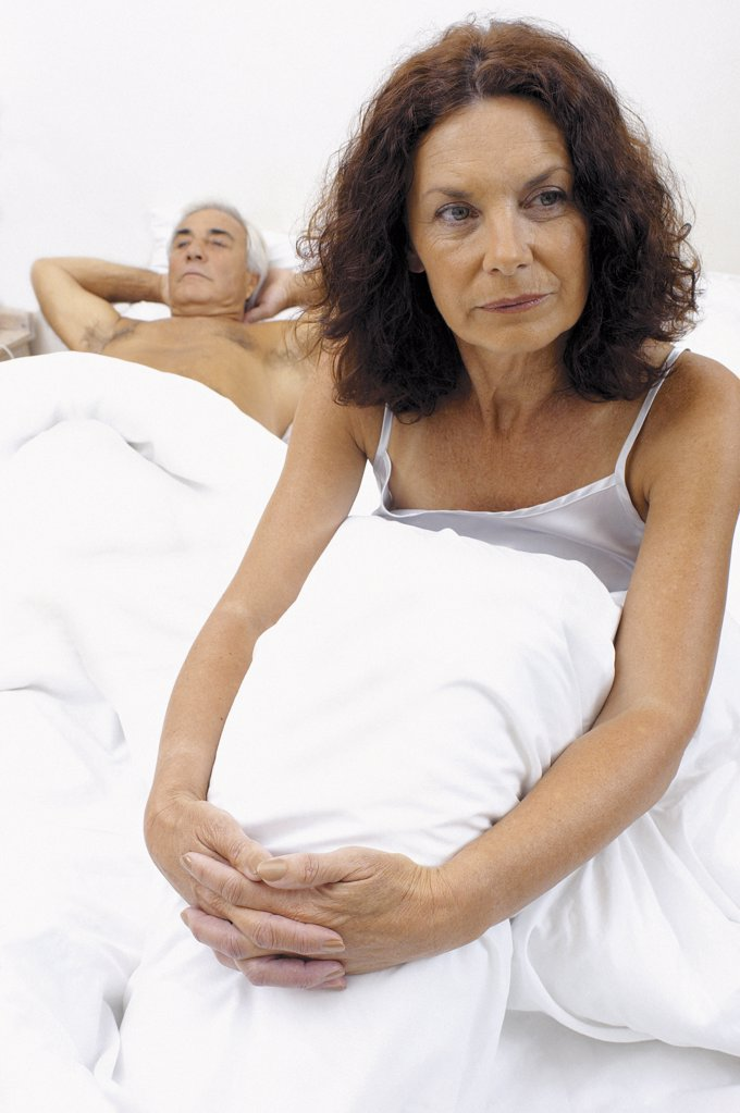 Stock Photo: 1439R-88011 Woman in bed