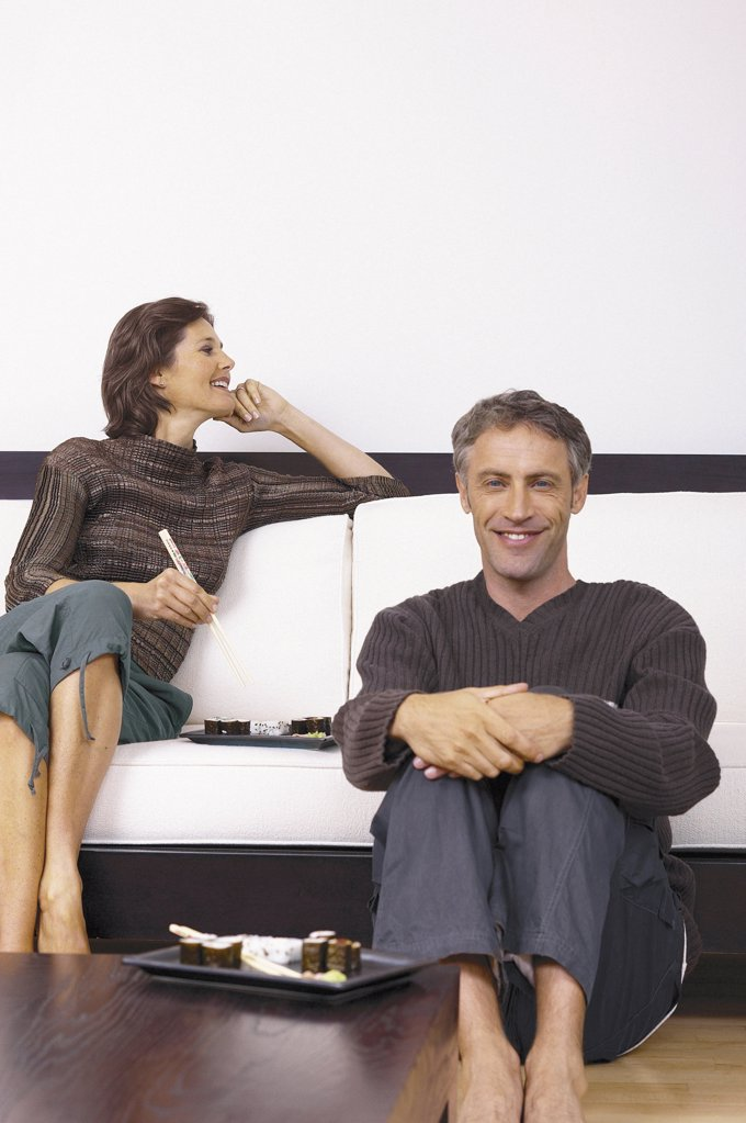 Man and woman in sitting room : Stock Photo