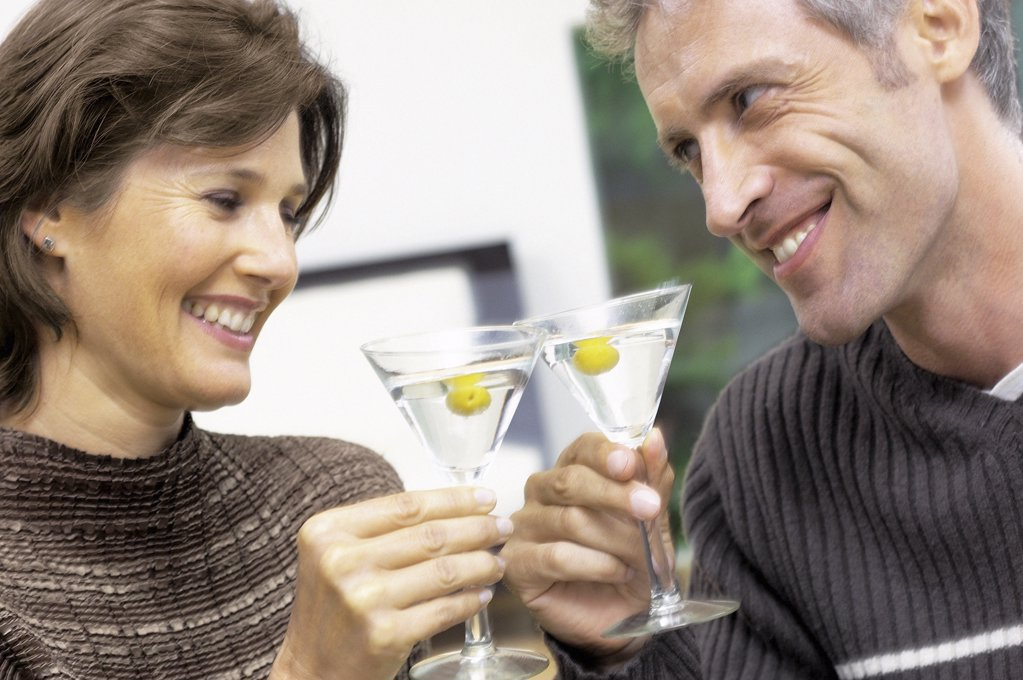 Man and woman having a cocktail : Stock Photo