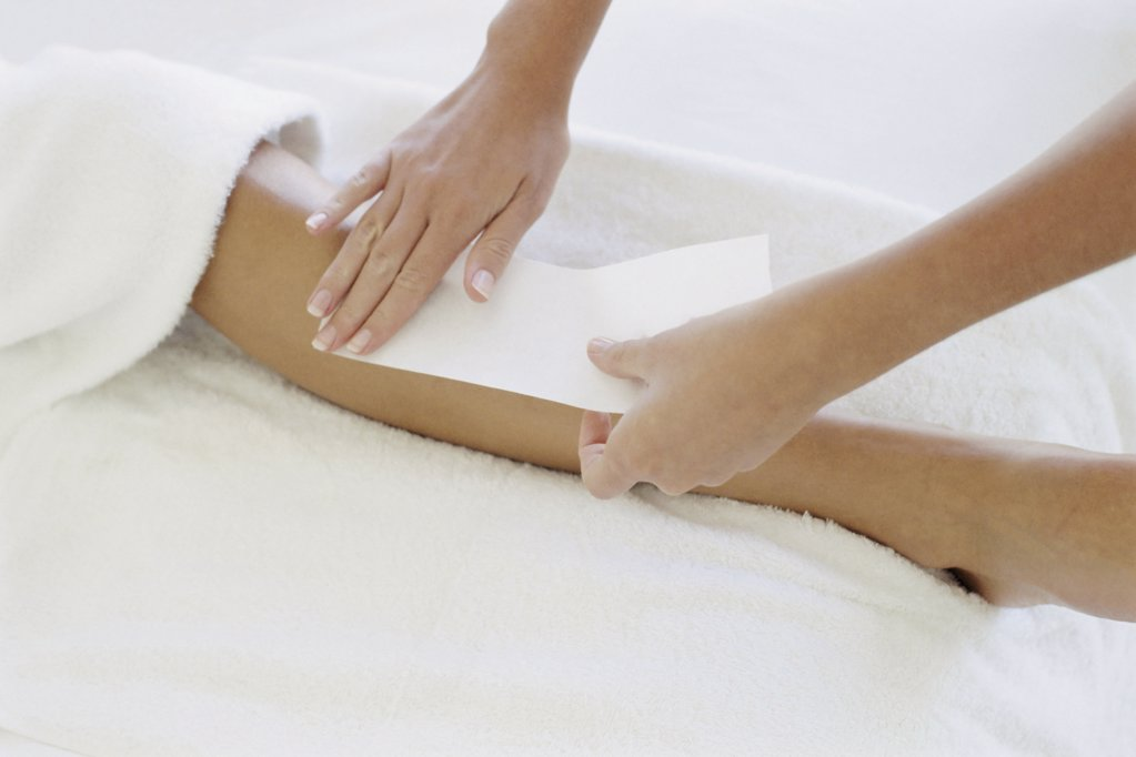 Woman being waxed : Stock Photo
