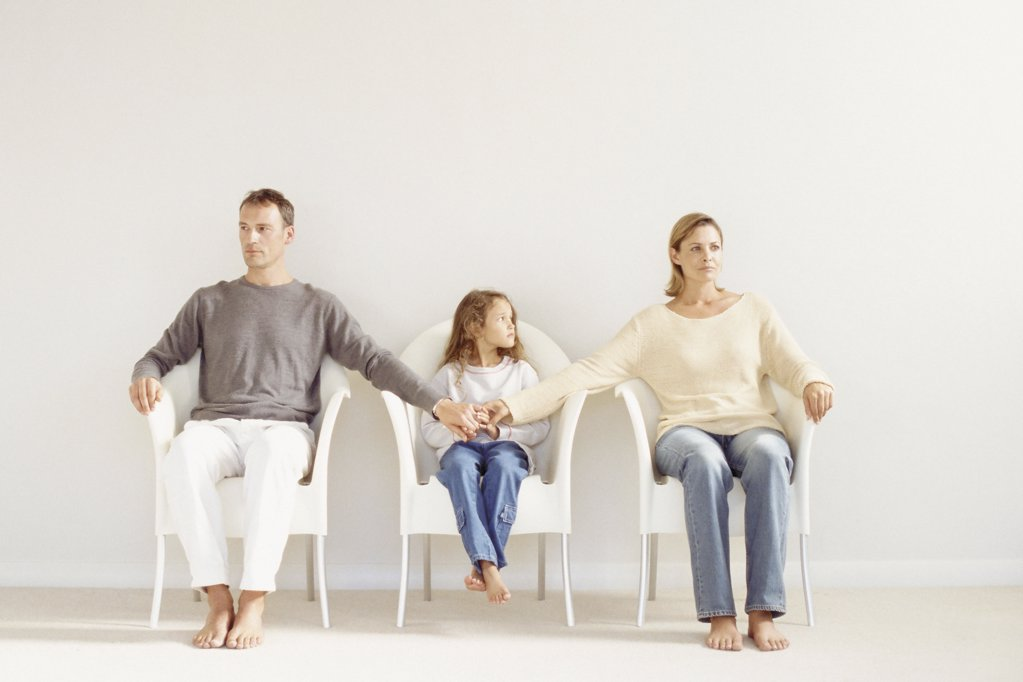 Family sitting in a row : Stock Photo