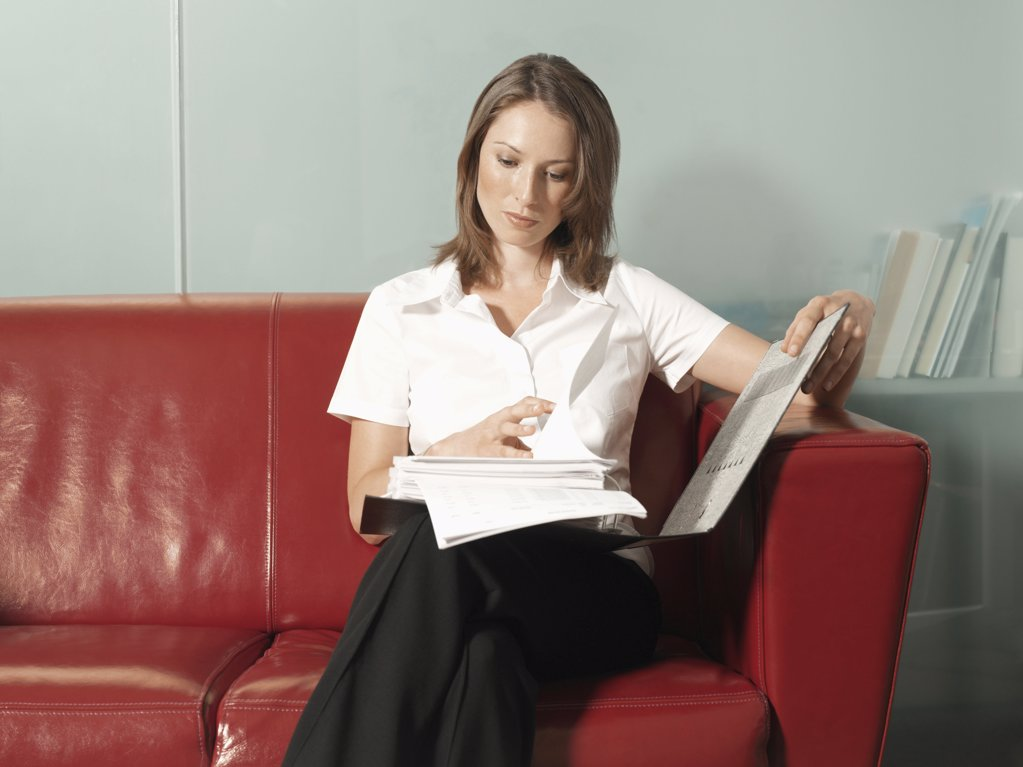 Woman reading a report : Stock Photo
