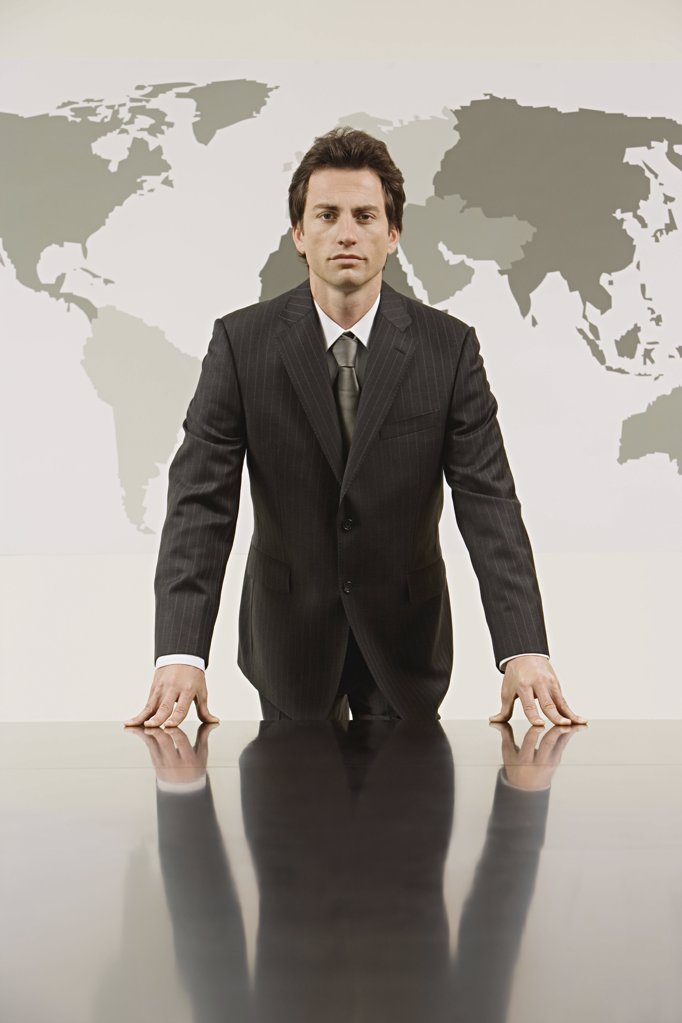 Businessman in front a map of the world  : Stock Photo