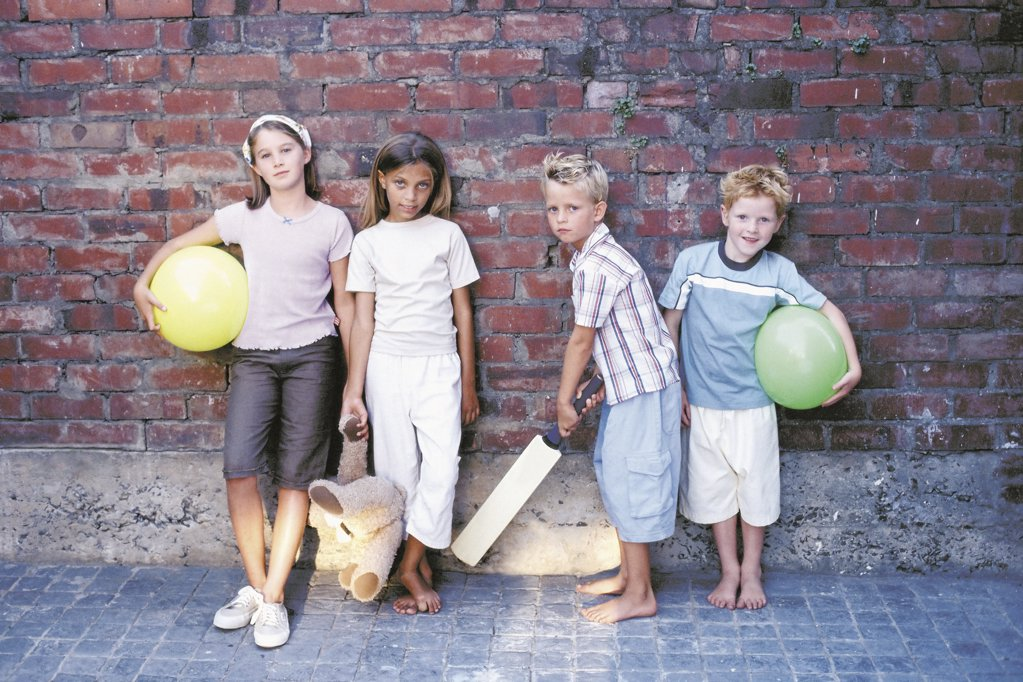 Portrait of boys and girls with their toys : Stock Photo