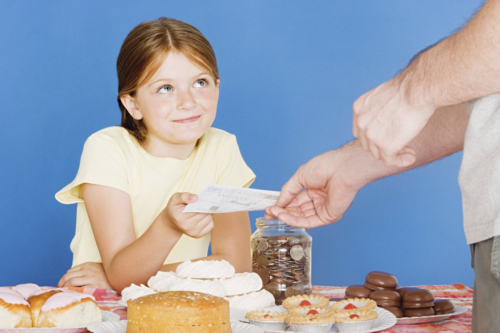 Man buying cake from girl : Stock Photo